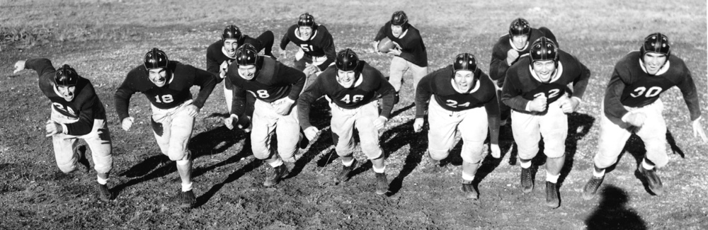 A group photo of the TCU football team in uniform in 1938