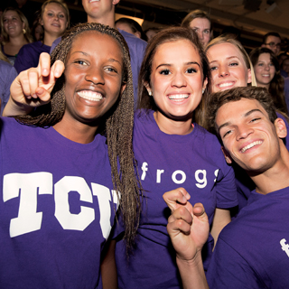Three diverse students showing the frog hand sign