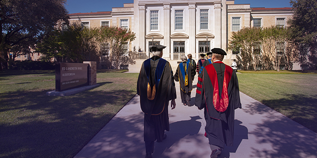 TCU faculty in regalia process to Ed Landreth Hall