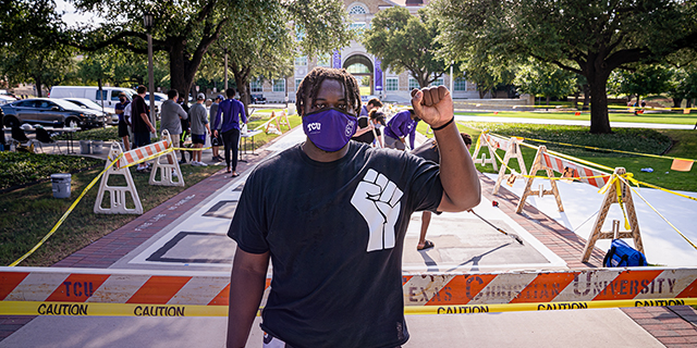 TCU student Kellton Hollins with his End Racism mural project