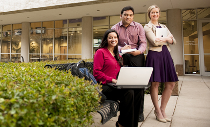 Three TCU Neeley MBA students sit outside the business building