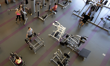 Students working out in the rec center weight room