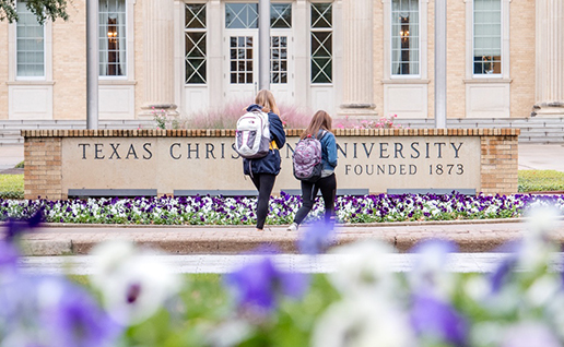 Students walking in front of TCU library