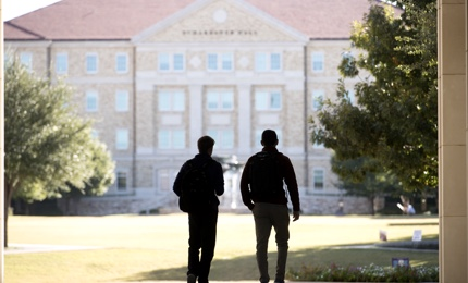 Two male students walking to class