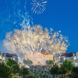 Fireworks exploding in the night sky over the campus commons Scharbauer Hall