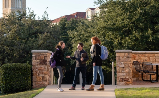 Students stopping to chat on campus