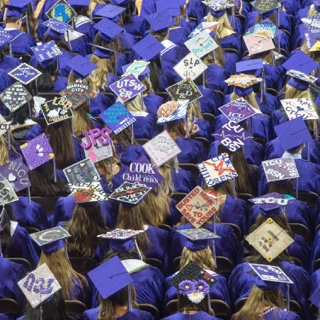 Overhead view of TCU nursing graduates' decorated caps at Commencement