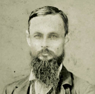 A black and white portrait of TCU founder Randolph Clark, a middle-aged bearded man, in 1874.