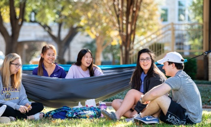Students enjoying a nice day outside on campus