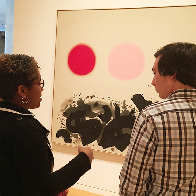 Two TCU students view a painting at Fort Worth's Modern art museum