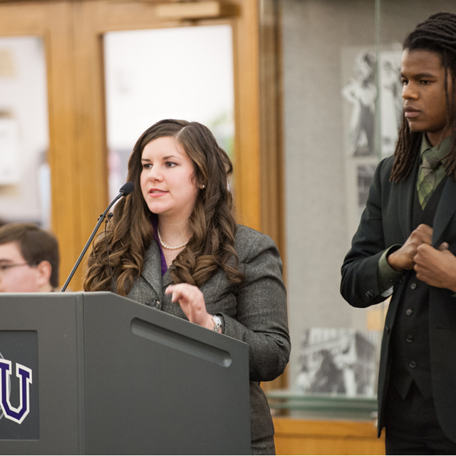 Students engage in a debate competition