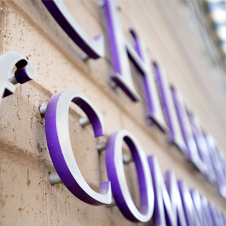 Close up photo of raised purple building signage