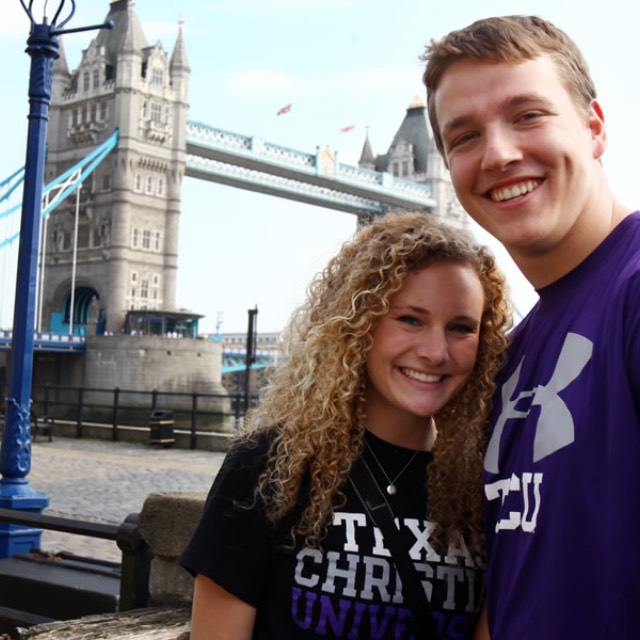 A female and male student standing in front of Tower Bridge in London