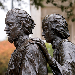 A bronze statue of TCU founders Addison and Randolph Clark