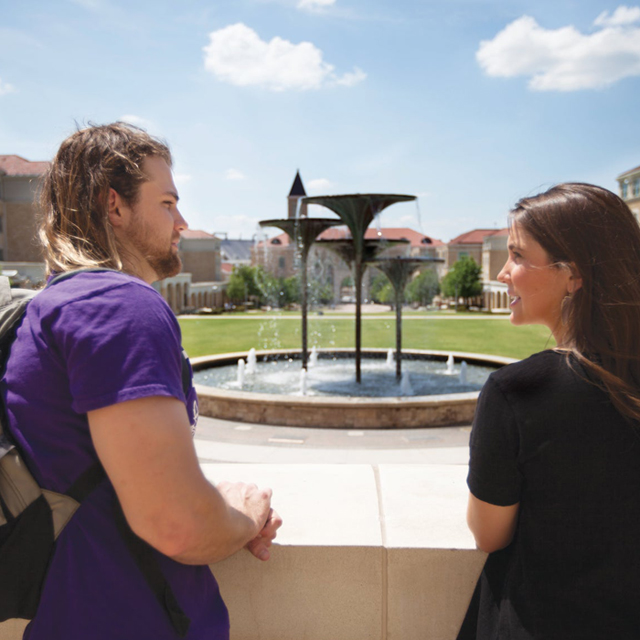 students with Frog Fountain in the background