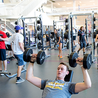 The TCU rec center is busy with dozens of students using the weights and equipment